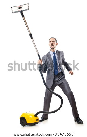 Vacuum cleaning by businessman on white - stock photo