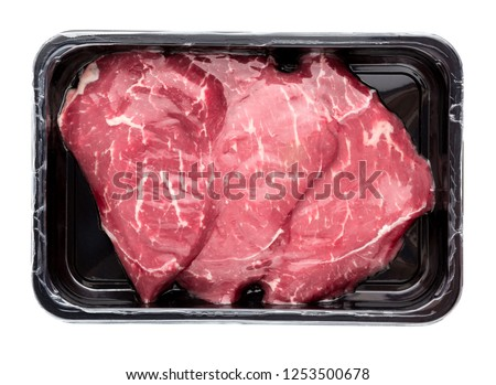 Vacuum-packed beef on a white background. Marbled beef from the store isolated on a white background.