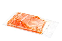 Vacuum packed salmon portion fillet isolated on white background, front view