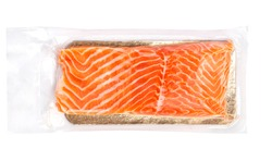 Vacuum packed salmon portion fillet isolated on white background, top view