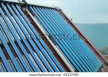 Vacuum solar water heating system on the house roof.