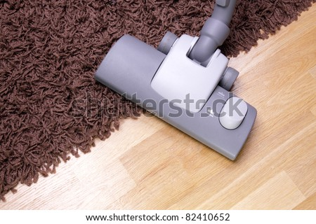 vacuuming the carpet in the house