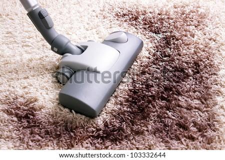 Vacuuming very dirty white  carpet