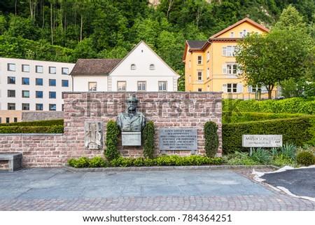 Vaduz, Liechtenstein - May 28, 2016: A statue of musician and composer Josef Gabriel von Rheinberger next to the music school in Vaduz, capital of the Principality of Liechtenstein.