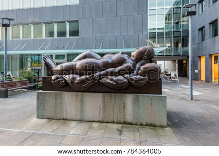 Vaduz, Liechtenstein - May 28, 2016: Bronze sculpture Fernando Botero of a nude woman lying on her back (Resting woman, 1993) in Vaduz, Liechtenstein.