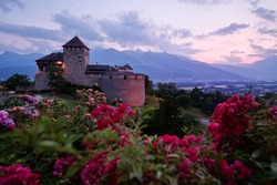Vaduz Royal castle in Liechtenstein. Scenic landscape of old medieval castle in Alps mountains in summer. Beautiful view of Alpine nature.