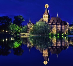 Vajdahunyad Castle in a fullmoon is reflected in water, Budapest