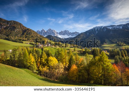 Val di Funes, Trentino Alto Adige, Italy. The great autumnal colors shines under the late sun with Odle on the background and Santa Magdalena Village on the foreground. #335646191