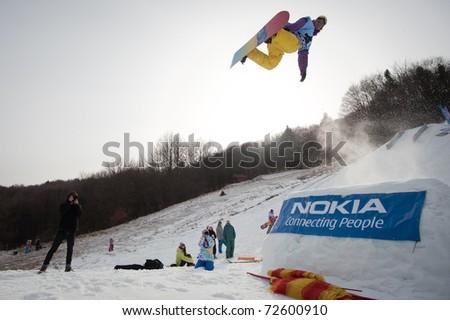 VALCA, SLOVAKIA - FEBRUARY 13: jump of  Anders Haugvad at Nokia Freestyle Tour 2011 February 13, 2011 in Valca, Slovakia