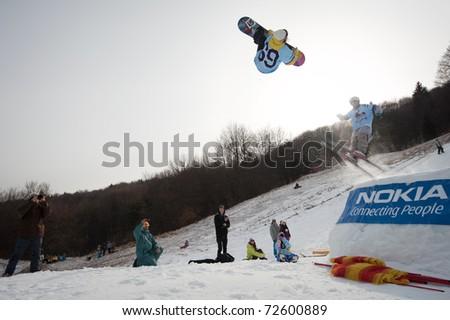 VALCA, SLOVAKIA - FEBRUARY 13: jump of  Klaudia Medlova at Nokia Freestyle Tour 2011 February 13, 2011 in Valca, Slovakia