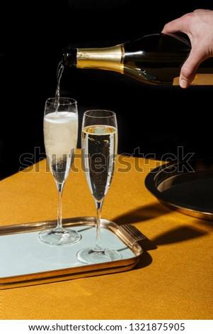 Valdobbiadene Cartizze Prosecco flutes and a bottle, in pop contemporary style. Prosecco is an italian sparkling wine cultivated and produced in Valdobbiadene-Conegliano area #1321875905
