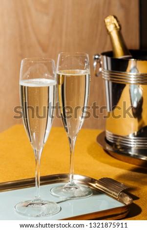 Valdobbiadene Cartizze Prosecco flutes and a bottle, in pop contemporary style. Prosecco is an italian sparkling wine cultivated and produced in Valdobbiadene-Conegliano area #1321875911