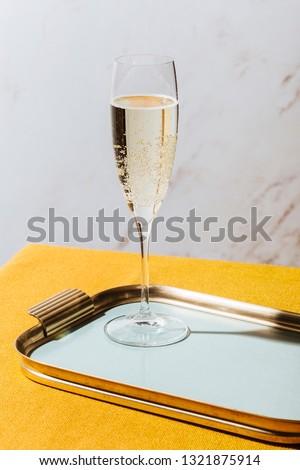 Valdobbiadene Cartizze Prosecco flutes and a bottle, in pop contemporary style. Prosecco is an italian sparkling wine cultivated and produced in Valdobbiadene-Conegliano area #1321875914