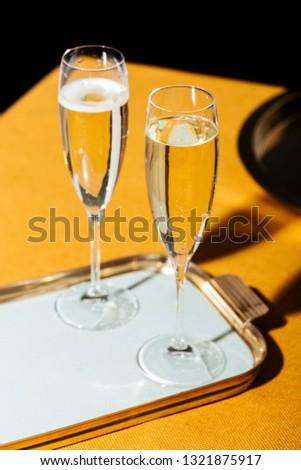 Valdobbiadene Cartizze Prosecco flutes and a bottle, in pop contemporary style. Prosecco is an italian sparkling wine cultivated and produced in Valdobbiadene-Conegliano area #1321875917