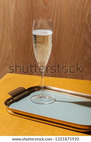 Valdobbiadene Cartizze Prosecco flutes and a bottle, in pop contemporary style. Prosecco is an italian sparkling wine cultivated and produced in Valdobbiadene-Conegliano area #1321875920
