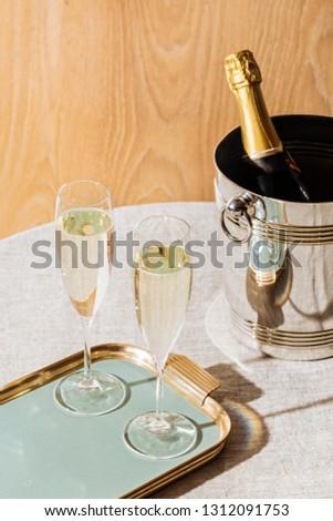 Valdobbiadene Prosecco flutes and a bottle, in pop contemporary style. Prosecco is an italian sparkling wine cultivated and produced in Valdobbiadene-Conegliano area #1312091753