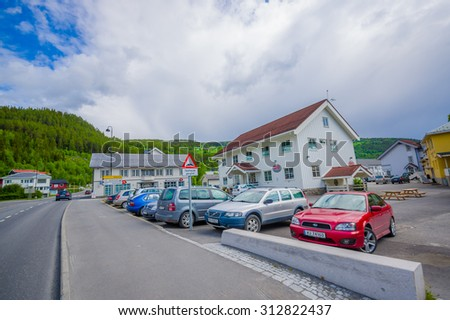 VALDRES, NORWAY - 6 JULY, 2015: Charming small town of Fagernes with small city buildings sorrounded by green mountains.