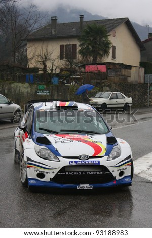 VALENCE, FRANCE - JANUARY 20 : French Driver Francois Delecour crosses Saint-Jean-en-Royans village during Monte Carlo Rally, on January, 20, 2012 in Valence, France.