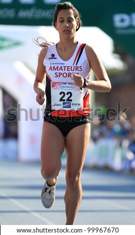 VALENCIA - APRIL 1: Miriam Gregori Romero finishing her race in women race against cancer in Valencia on April 1, 2012 in Valencia, Spain - stock photo