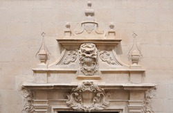 Valencia Gothic Style detail over doorway of Santa Maria Basilica the oldest active church in Alicante built between the 14th and 16 century in Casco Antiquo (spanish for Old Town) neighborhood