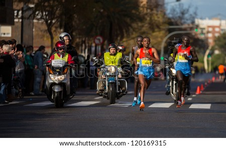 VALENCIA - NOVEMBER 18: Gemechu Worku Biru (number 3) leads the first group at 32 km marker of mens marathon, in Valencias marathon on November 18, 2012 in Valencia, Spain