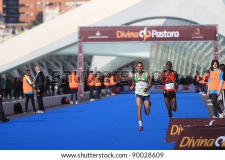 VALENCIA - NOVEMBER 27: kisang (number 7) and Wissam (number 17) sprinting in their participation in mens marathon race at finish line in Valencias Marathon on November 27, 2011 in Valencia, Spain