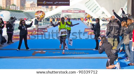 VALENCIA - NOVEMBER 27: kosgei (number 8) winning the mens marathon race at finish line in Valencias Marathon on November 27, 2011 in Valencia, Spain