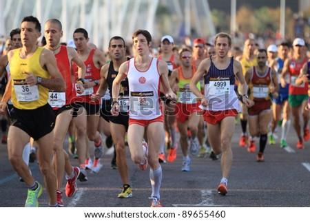 VALENCIA - NOVEMBER 27: unidentified group of runners participating in Valencias Marathon on November 27, 2011 in Valencia, Spain