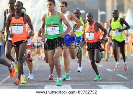 VALENCIA - NOVEMBER 27: unidentified group of runners starting the race and participating in Valencias Marathon on November 27, 2011 in Valencia, Spain