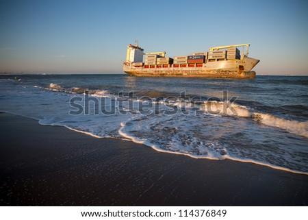 "VALENCIA - OCTOBER 1: Celia St Johns cargo ship aground on ""el saler"" beach after big temporal in Valencia on October 1, 2012 in Valencia (Spain)."