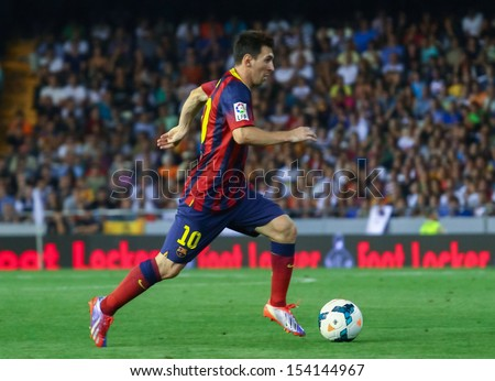 VALENCIA SEP 01 Leo Messi of FC Barcelona in action during a Spanish League match between Valencia CF and FC Barcelona at the Mestalla Stadium on September 01 2013 in Valencia Spain