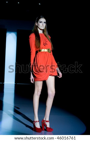 VALENCIA, SPAIN - FEBRUARY 3:  A model takes to the catwalk wearing a creation by Spanish designer Juan Vidal, presented at the 8th Valencia Fashion Week on February 3, 2010 in Valencia, Spain.