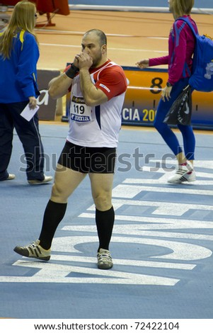 """VALENCIA, SPAIN - FEBRUARY 19: Hammer thrower """"Manolo martinez"""" competitor of hammer thrower Men of the spanish indoor national championships at Valencia on February 19, 2011 in Valencia, Spain"""