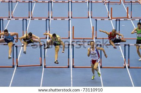 VALENCIA, SPAIN - FEBRUARY 20: Indoor track and field spanish national championship. Runners in the final, Felipe Vivanco wins men's 60m hurdles sprint on February 20, 2011 in Valencia, Spain