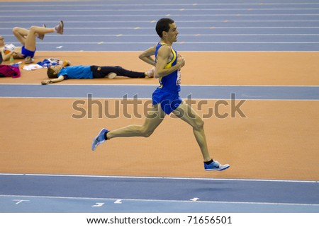 "VALENCIA, SPAIN - FEBRUARY 19: ""Jesus Espana"", winner of 3000m Men of the spanish indoor national championships at Valencia on February 19, 2011 in Valencia, Spain"