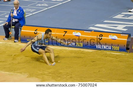 """VALENCIA, SPAIN - FEBRUARY 19: Long jump competitor """"MARIN FRIAS MA"""" of long jump Men of the spanish indoor national championships at Valencia on February 19, 2011 in Valencia, Spain"""