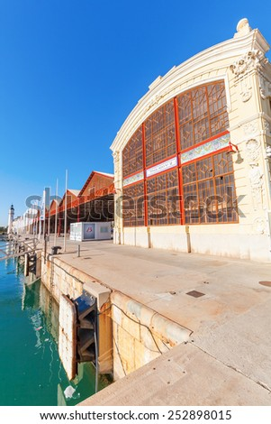 VALENCIA, SPAIN - FEBRUARY 08, 2014: port building where the 32. Americas Cup was held up in 2007. It is a trophy awarded to the winner of the America\'s Cup match races between two sailing yachts