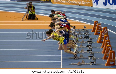 VALENCIA, SPAIN - FEBRUARY 20: Start of the Indoor track and field spanish national championship. Runners in the start line men's 60m sprint on February 20, 2011 in Valencia, Spain