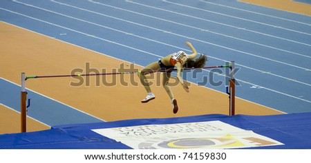 VALENCIA, SPAIN - FEBRUARY 19: Unidentified high jump competitor performs at the Spanish Indoor Womens National Championships at Valencia on February 19, 2011 in Valencia, Spain - stock photo