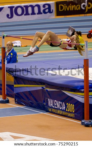 VALENCIA, SPAIN - FEBRUARY 19: Unidentified high jump competitor performs in the Spanish Indoor Womens National Championships on February 19, 2011 in Valencia, Spain