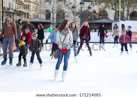 VALENCIA, SPAIN - JAN 06: The general public ice skates at an outdoor rink at the central plaza in Valencia, Spain on January 6, 2014. This is the first time an ice rink has been set up in Valencia.
