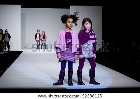 VALENCIA, SPAIN - JANUARY 23: Angelina Fernandez, age 12, and Maria Gutierrez, age 11, of Valencia in the Valencia Children's Fashion Show (designer Girandola) on January 23, 2010 in Valencia, Spain.