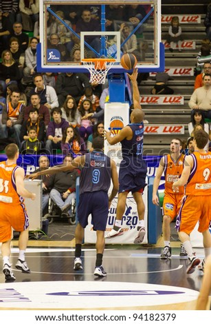 VALENCIA, SPAIN - JANUARY 28: Jayson Granger (blue shirt) scoring during the ACB league match between Valencia Basket  and Asefa Estudiantes, 85-71, on January 28, 2012, in Valencia, Spain