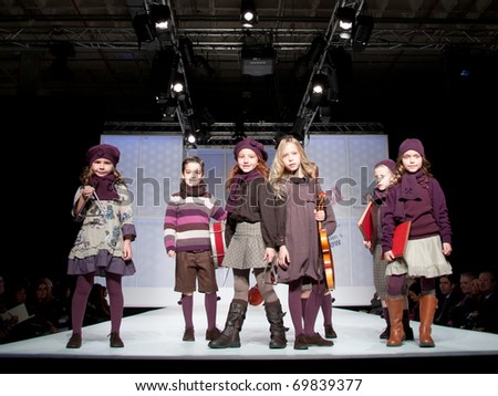 VALENCIA, SPAIN - JANUARY 21: Unidentified child models walk the runway at the FIMI Children's Winter Fashion Show for designer Condor in the Feria Valencia on January 21, 2011 in Valencia, Spain.