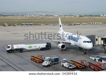 VALENCIA, SPAIN - JUNE 2: Spanair and Singapore Airlines have signed a codeshare agreement to ease connections. A Spanair at the gate at the Valencia Airport on June 2, 2010 in Valencia, Spain.
