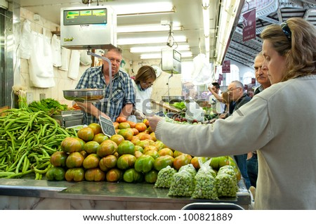 VALENCIA, SPAIN - MARCH 30: Shopping in the Colon market. The building was opened on Christmas eve 1916 to great public acclaim. March 30, 2012 in Valencia, Spain. - stock photo
