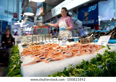 VALENCIA, SPAIN - MARCH 30: Shopping in the Colon market. The building was opened on Christmas eve 1916 to great public acclaim. March 30, 2012 in Valencia, Spain.