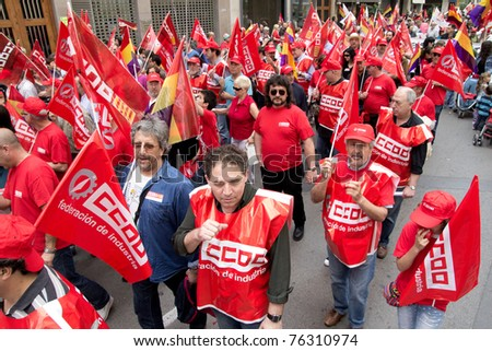 VALENCIA, SPAIN - MAY 1:  Labor Unions take to the streets of Valencia to march against the reduction of worker rights on May 1, 2011 in Valencia, Spain.