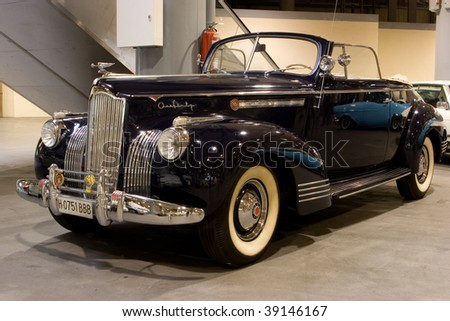 VALENCIA, SPAIN - OCTOBER 16 : Restored 1942 Packard 160 Convertible on display at the 2009 Motor Epoca Classic Car Show on October 16, 2009 in Valencia, Spain. - stock photo