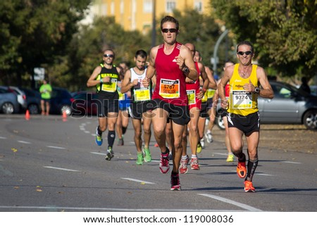 VALENCIA, SPAIN - OCTOBER 21: Runners compete in the XXI Valencia Half Marathon on October 21, 2012 in Valencia, Spain.